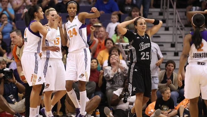 Becky Hammon (25), shown during a 2011 WNBA game against the Phoenix Mercury, is expected to become the first woman to be interviewed for a NBA head coaching job.