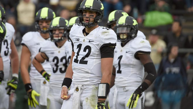 Oct 11, 2014; West Lafayette, IN, USA; Purdue Boilermakers quarterback Austin Appleby (12) looks for instructions from the bench as his teammates wait at Ross Ade Stadium. Mandatory Credit: Sandra Dukes-USA TODAY Sports