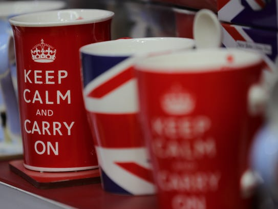 Tourist mugs are seen for sale in a shop in Whitehall