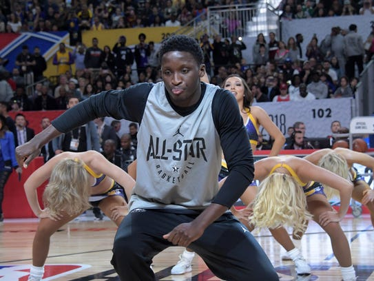 Indiana Pacers guard Victor Oladipo dances with Los