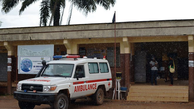 An ambulance is parked in front of the Kenema Government Hospital, in Sierra Leone, on August 16, 2014.