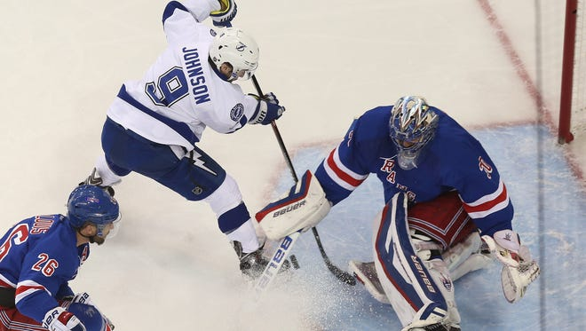 Tampa Bay's Tyler Johnson made life miserable for Henrik Lundqvist and the Rangers on Monday at Madison Square Garden. Johnson scored three of the Lightning's six goals.