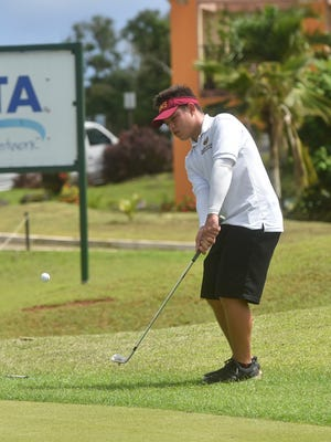 Father Duenas Memorial School golfer Brentt Salas, 16, attempts a chip shot during the Independent Interscholastic Athletic Association of Guam Golf League All-Island tournament at the Guam International Country Club in Dededo on Oct. 3. Salas captured his third consecutive title with a score of 72.