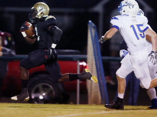Jajuan Foutch of Friendship Christian runs the ball
