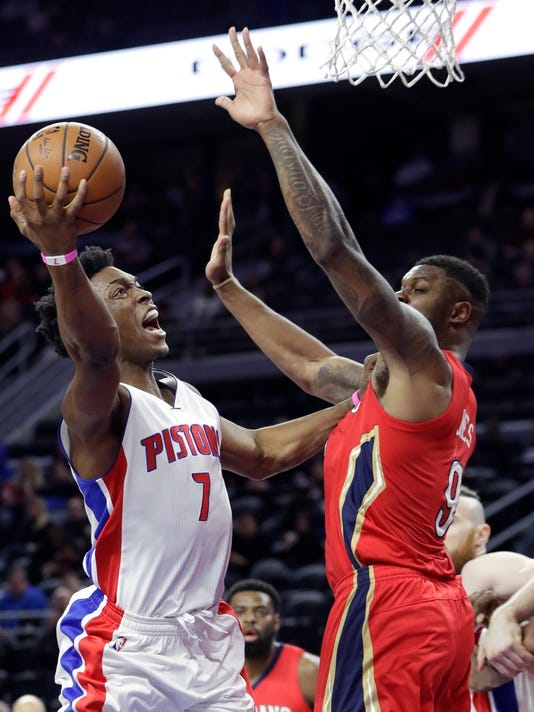 Detroit Pistons forward Stanley Johnson (7) shoots over the defense of New Orleans Pelicans forward Terrence Jones (9) during the first half of an NBA basketball game, Wednesday, Feb. 1, 2017, in Auburn Hills, Mich. (AP Photo/Carlos Osorio)