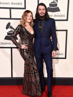 Adriel Denae and Cory Chisel pose for a photo on the red carpet at Monday's Grammy Awards in Los Angeles.