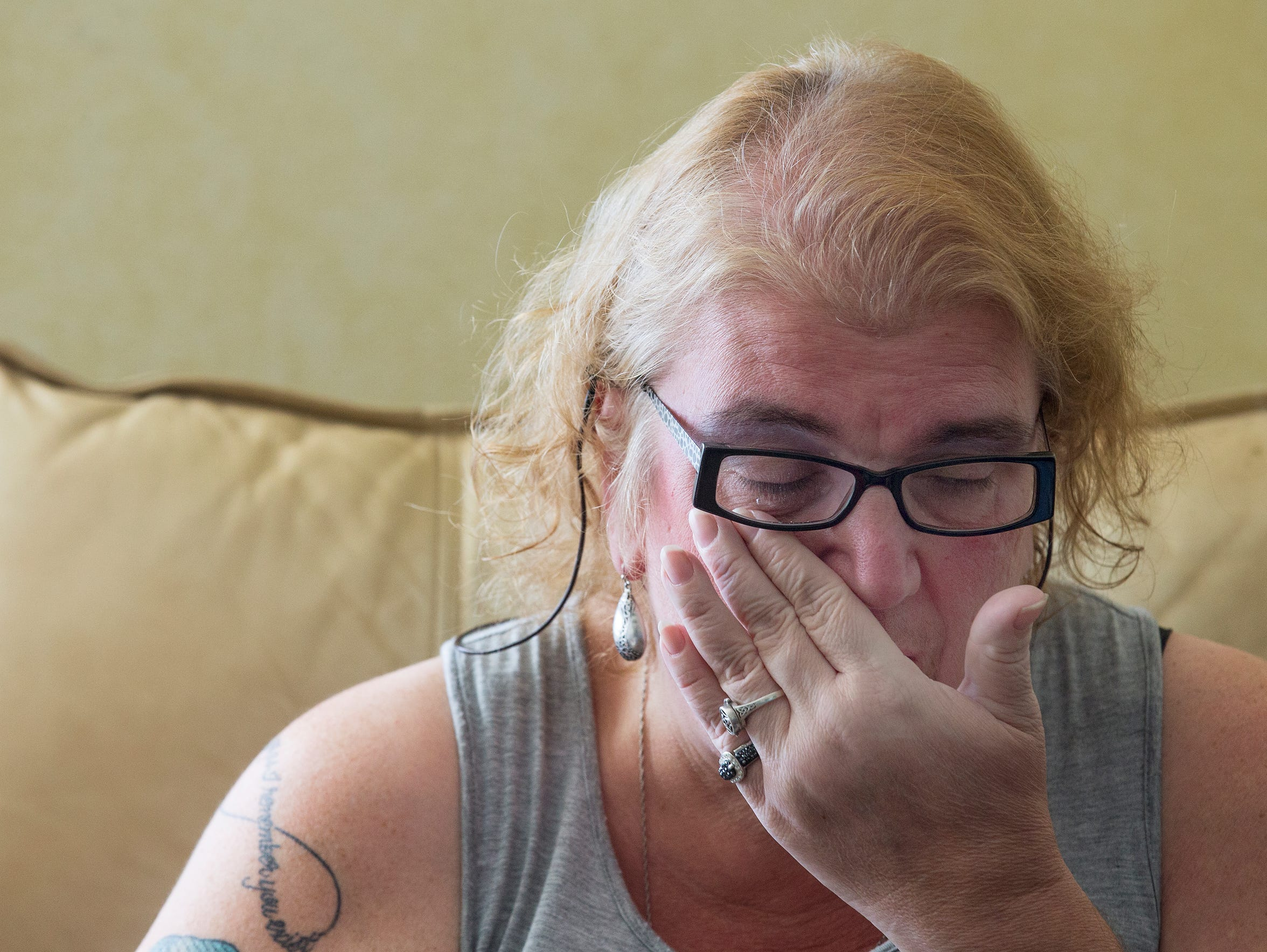 Cindi Byersmith wipes a tear away from her eye as she