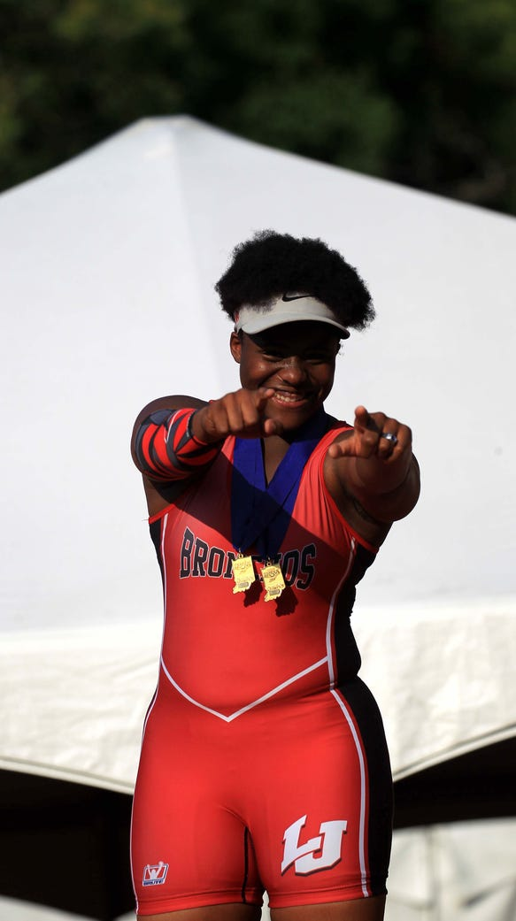 Essence Henderson of Lafayette Jeff celebrates her