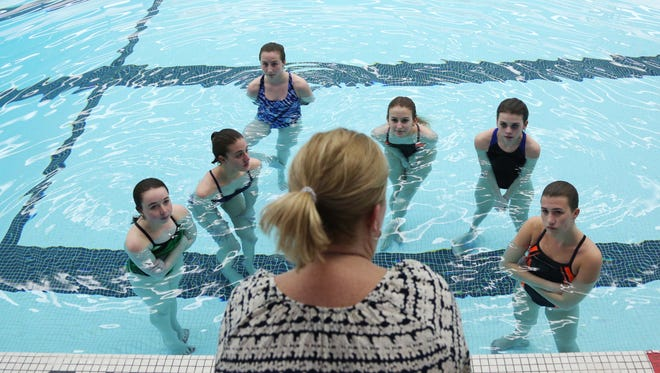 Susan VandeVenter, coach for the Valley High School Tigerlillies synchronized swim team, talks to a group of freshman girls during practice on Tuesday, March 29, 2016, at the Valley High School pool. The team of swimmers is preparing for its water show on the second weekend in April.