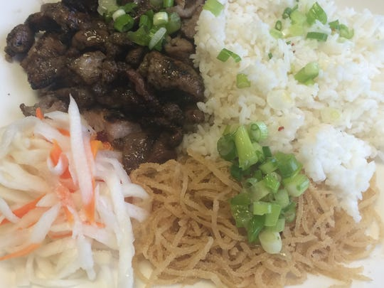An order of pork chop and shredded pork with rice at Sun  Cafe in Iowa City on April 28, 2016.