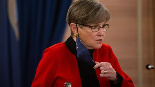 Gov. Laura Kelly removes her mask to answer questions regarding COVID cases thorughout the state at Wednesday's news conference at the Statehouse.