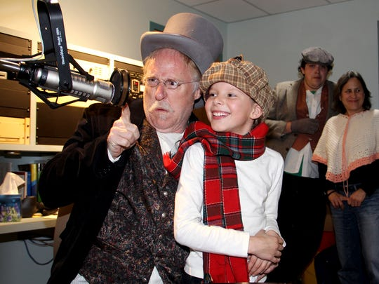 "Charles Pike, left, and Devyn Erikson are pictured during KSJE's on-air performance of ""A Christmas Carol"" last year."