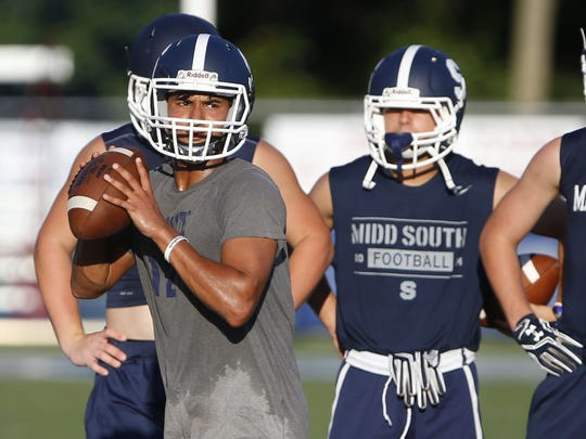 Quarterback Aneesh Agrawal  during Middletown South football practice on August 17.