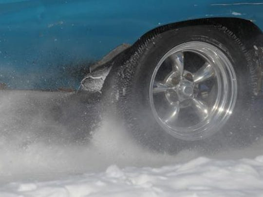 The right rear wheel of a 1972 Chevelle SS driven by Travis Arndt of Wisconsin Rapids shoots back a spray of ice during the Merrill Ice Drags last Feburary at Council Grounds State Park near Merrill.
