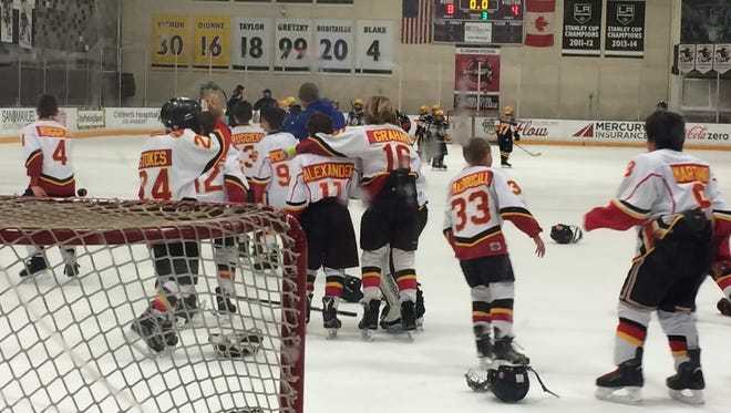 The Desert Blaze 9- and 10-year-old team celebrates a championship Saturday.