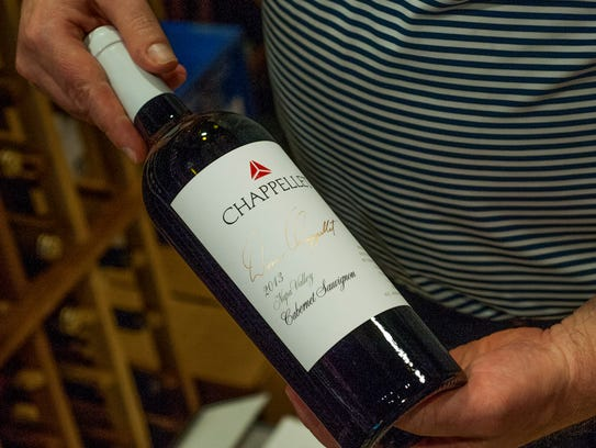 Ted Klose, owner of Ted The Wine Guy & Co., holds a