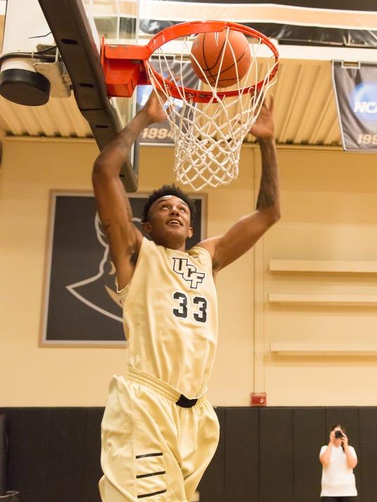 Basketball-press-day-2014-Shaheed-Davis-slam-dunk
