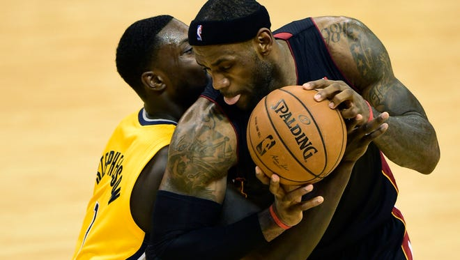 Heat forward LeBron James leans into Pacers guard Lance Stephenson during the second half of Game 2 of the Eastern Conference Finals.