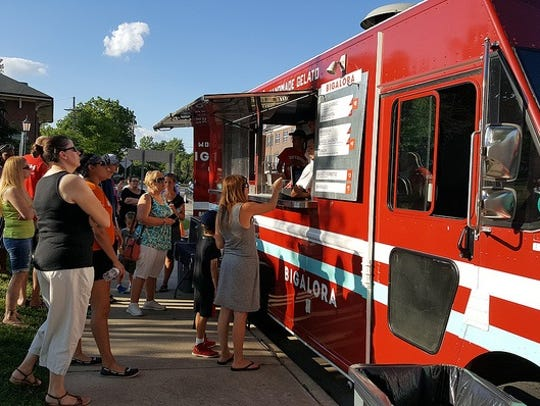 Food trucks, including some offering gourmet fare,