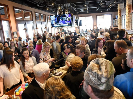 People fill the lobby area while waiting for tables Sunday during brunch service at Granite City Food & Brewery in St. Cloud.