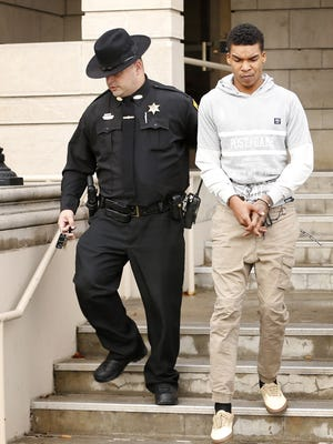 Marquise Sutton, 21, of Elmira, is escorted out of Elmira City Court on Thursday after his arraignment in the fatal shooting of Anthony Garrett, 27.