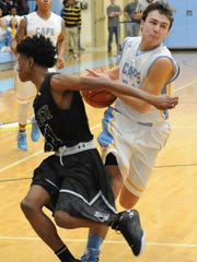 Cape's Drew Mulcahy goes for a basket past Tech's Brandon Palmer as Cape Henlopen defeated Sussex Tech 60-53 at the school near Lewes on Wednesday.