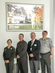 Employees of Harrisburg International Airport and Gettysburg and Eisenhower Parks are shown in front of a new display ad at Harrisburg International Airport. Pictured, from left, are: Ahna Wilson, site manager at Eisenhower National Historic Site; Scott Miller, public relations deputy director of Harrisburg International Airport; Timothy Edwards, executive director of Harrisburg International Airport; and Ed W. Clark, superintendent of Gettysburg National Military Park and Eisenhower National Historic Site.