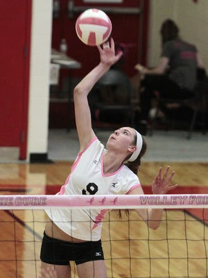 Lakota West starter Maya Krause gets a kill from the outside position last year.