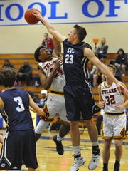 Central Valley Christian's Grant Highstreet attempts to make a block in a game at the 66th annual Polly Wilhelmsen Invitational in 2016.