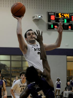 Rider's Conner Chamberlain puts up a short jumper in the Region I-5A Bi-district playoffs against Chisholm Trail Tuesday, Feb. 21, 2017, in Jacksboro.