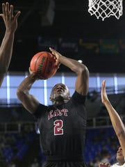Memphis East's Alex Lomax (2) goes up for a shot as