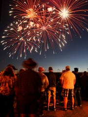 People watch the Bremerton Blast fireworks display
