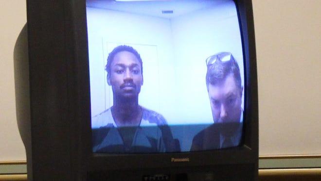 Deonte Baber appears for an arraignment via video