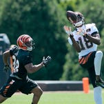 Wide receiver A.J. Green (18) makes a catch during OTAs at the Bengals' practice field next to Paul Brown Stadium in downtown Cincinnati, on Tuesday, May 24, 2016.