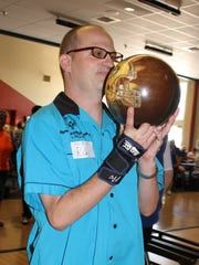 Deming Roadrunner Riley Tolman sizes up a strike during Saturday's New Mexico Special Olympics Regional Bowling Tournament at the Starmax Bowling Center. Athletes were qualifying for state competition that will be held Oct. 3-31 in Las Cruces.