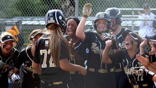 Nebraska Gold's Bobbi Singleton (72) is greeted at home by her teammates after hitting a two-run home run in the Originals vs. Nebraska Gold championship game of the 16U ASA/USA Softball Gold National Championship tournament at Wallace Marine Park in Salem, Ore., on Saturday, July 25, 2015. The Originals, of Lee's Summit, Mo., won the first of the double elimination game 10-6.