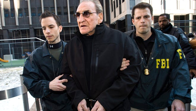 Vincent 'Vinny' Asaro, the reputed head of the Bonanno crime family, is escorted by FBI agents out of a federal building in New York City on Jan. 23.