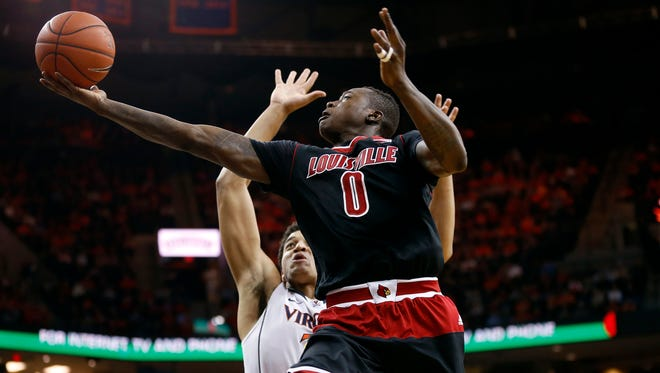 Feb 7, 2015; Charlottesville, VA, USA; Louisville Cardinals guard Terry Rozier (0) shoots the ball as Virginia Cavaliers forward Isaiah Wilkins (21) defends in the second half at John Paul Jones Arena. The Cavaliers won 52-47. Mandatory Credit: Geoff Burke-USA TODAY Sports