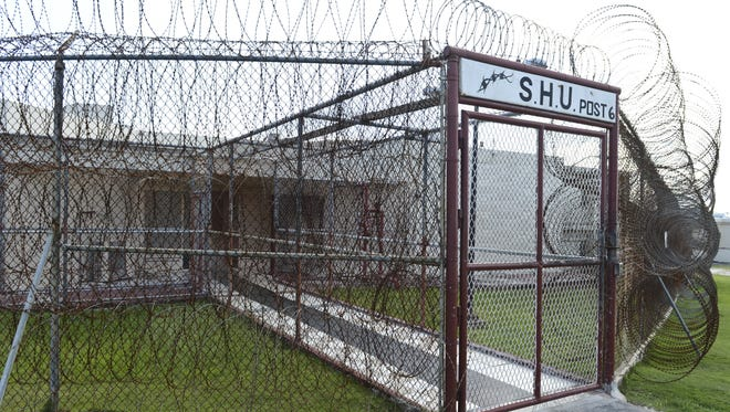 In this file photo, razor wire surrounds the special housing unit at the Department of Corrections.
