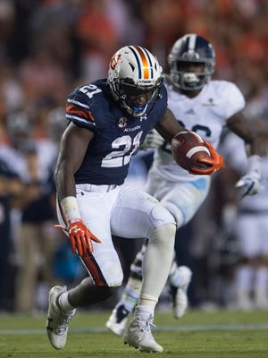 Auburn running back Kerryon Johnson (21) runs downfield before falling over with an injury during the NCAA football game between Auburn vs. Georgia Southern on Saturday, Sept. 2, 2017, at Jordan Hare Stadium in Auburn, Ala.
