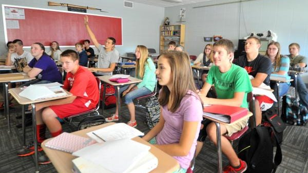 "Students participate Tuesday afternoon, Sept. 16, 2014, in a class discussion at Marathon High School. The school and Marathon School District both were ranked as ""exceeds expectation"" by the state Department of Public Instruction."