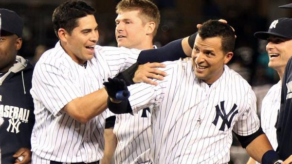 Yankees second baseman Martin Prado (right) and center fielder Jacoby Ellsbury exult after Prado hit a walk-off single in the bottom of the ninth inning against the Chicago White Sox at Yankee Stadium. The Yankees defeated the White Sox 4-3.