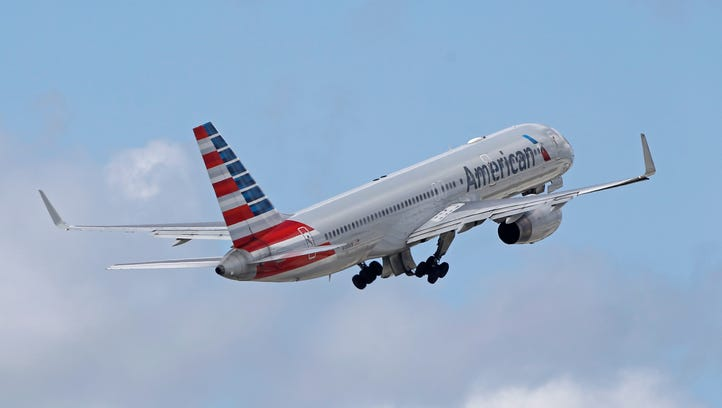 An American Airlines passenger jet takes off from Miami