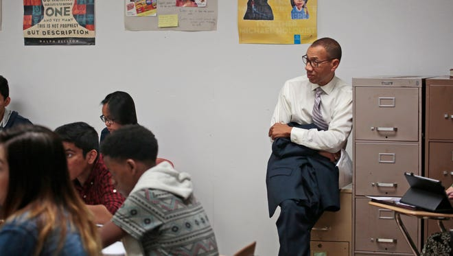 Dennis Walcott, East Ramapo school district monitor, sits in on a class at Ramapo High School on Sept. 30, 2015.