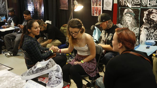 """""""My intention is to educate people as to why they should come to a tattoo convention,"""" says Lou Di Monaco, the convention's operator."""