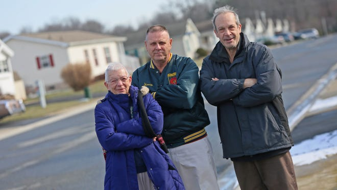 Left to right: Joan Peculski, president; Milton Stroup, vice president; and Richard Ruben, treasurer, of the Bon Ayre Civic Association, stand on Saks Street. Residents have been fighting with the landowner over lot rent increases for years.