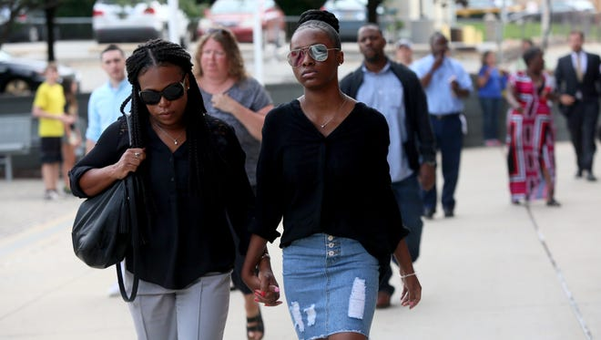 Trinity Carr, 16, one of the three girls charged in the fatal assault of a Howard High School of Technology student, walks into the New Castle County Courthouse on Aug. 8. Amy Inita Joyner-Francis was a student at Howard High School.