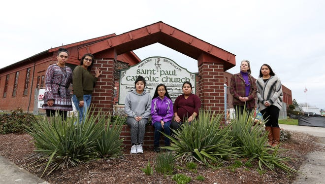 Andrea Ponce, left, Magaly Nino, Maria Mendez, Aliyah Romualdo, Remedios Ortiz, an administrative assistant for Somos Hispanas Unidas; Susana Ghio, Executive Director of Somos Hispanas Unidas, and Gabriela Rodriguez are photographed in front of the Saint Paul Catholic Church on Thursday, March 2, 2017, in Silverton. Members of the Silverton Latino community say the church is planning to end its Spanish-language religious education classes.
