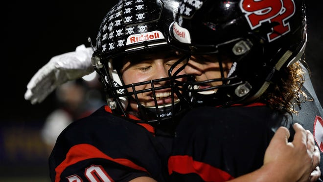SPASH players celebrate after defeating Fond du Lac to clinch a playoff berth Friday night in Stevens Point.