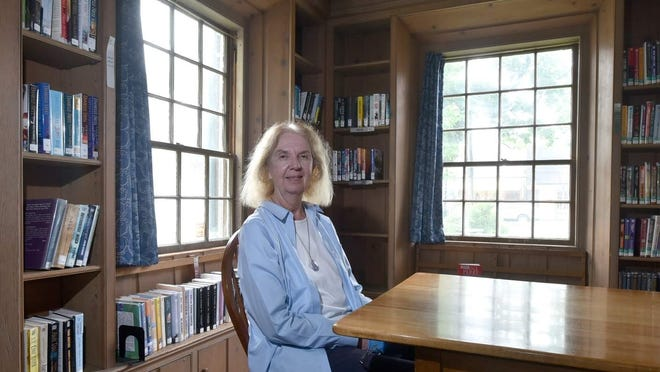 Hyannis Public Library Executive Director Carol Saunders on her last day of work after 48 years at the library. She has been lauded as an integral part of the downtown Hyannis community.